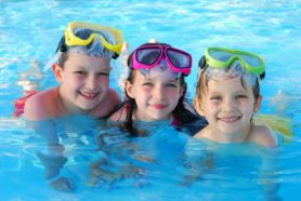 Three kids playing safely in the pool of their Outer Banks rental.