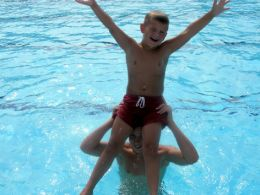 Boys playing around in the pool of their Outer Banks vacation home.